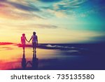 romantic couple walking at the... | Shutterstock . vector #735135580