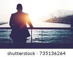 back view of male successful... | Shutterstock . vector #735136264