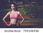 portrait of attractive fit... | Shutterstock . vector #735146938