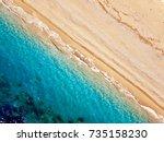 top view of a deserted beach.... | Shutterstock . vector #735158230