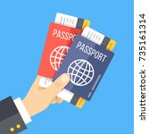 hand holding two passports with ... | Shutterstock .eps vector #735161314