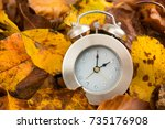 clock with leaves time change