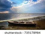 old boat on the beach | Shutterstock . vector #735178984