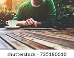 cropped image young man sitting ... | Shutterstock . vector #735180010