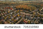 aerial drone image of suburbia... | Shutterstock . vector #735210583