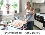 blond caucasian mom with a baby ... | Shutterstock . vector #735210793