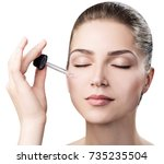 cosmetic oil applying on face... | Shutterstock . vector #735235504