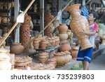 Ceramic Pots In A Shop In The...