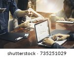young business people are... | Shutterstock . vector #735251029