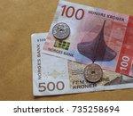 norwegian krone banknotes and... | Shutterstock . vector #735258694