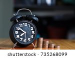 alarm clock and step of coins... | Shutterstock . vector #735268099