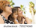 three generations of women....   Shutterstock . vector #735274360