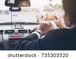 man eating donuts with coffee...   Shutterstock . vector #735303520