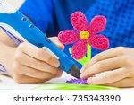 kid hands holding 3d printing... | Shutterstock . vector #735343390