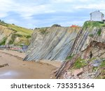 flysch rock formation and beach ... | Shutterstock . vector #735351364