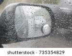 rain on the windshield and... | Shutterstock . vector #735354829
