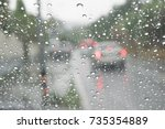 rain on the windshield and... | Shutterstock . vector #735354889