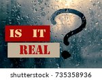 """Small photo of Drops of rain on the misted glass with a question mark; rhetorical question """"is it real?"""". Toned"""