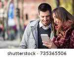 attractive young couple looking ... | Shutterstock . vector #735365506