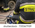 Small photo of ZAMOSC/POLAND -AUGUST 13,2017: Firefighters working on an auto vehicle extrication with a hydraulic power rescue tool. Letters STRAZ means Firefighter.
