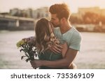 young man is giving beautiful... | Shutterstock . vector #735369109