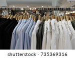 clothes on the rack  close up | Shutterstock . vector #735369316
