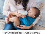 little infant baby lying on... | Shutterstock . vector #735395983
