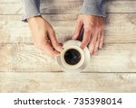 a man is drinking coffee.... | Shutterstock . vector #735398014