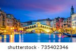 rialto bridge in venice  italy... | Shutterstock . vector #735402346