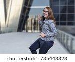 pretty business woman dancing...   Shutterstock . vector #735443323