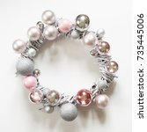 Small photo of Christmas wreath of decor, silver and pink balls, painted vine on white. Top view. Advent wreath.