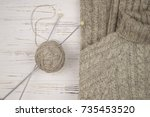 knitted gray wool sweater close ... | Shutterstock . vector #735453520