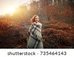 redhead girl at sunrise wrapped ...   Shutterstock . vector #735464143