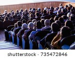 people in the auditorium during ... | Shutterstock . vector #735472846