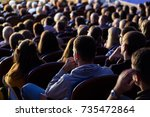 people in the auditorium during ...   Shutterstock . vector #735472864