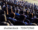 people in the auditorium during ... | Shutterstock . vector #735472960
