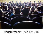 people in the auditorium during ... | Shutterstock . vector #735474046