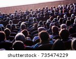 people in the auditorium during ... | Shutterstock . vector #735474229