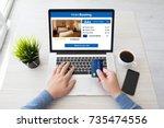 man hands holding credit card... | Shutterstock . vector #735474556