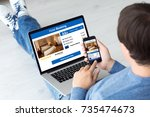 man holding computer and phone... | Shutterstock . vector #735474673