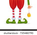 elf's legs and elf's hand with... | Shutterstock .eps vector #735480790
