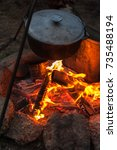 preparing food on campfire in... | Shutterstock . vector #735488194