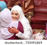 beautiful muslim bride hug her... | Shutterstock . vector #735491869