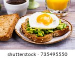 avocado egg sandwich with whole ... | Shutterstock . vector #735495550