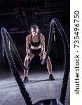 battle ropes session.... | Shutterstock . vector #735496750