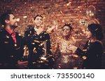 happy beautiful couples... | Shutterstock . vector #735500140