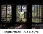 a view looking out to a pine... | Shutterstock . vector #735515098