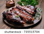 grilled sliced barbecue pork... | Shutterstock . vector #735515704