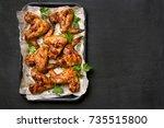 roasted chicken wings on baking ... | Shutterstock . vector #735515800
