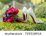 bridal bouquet and shoes on... | Shutterstock . vector #735518914